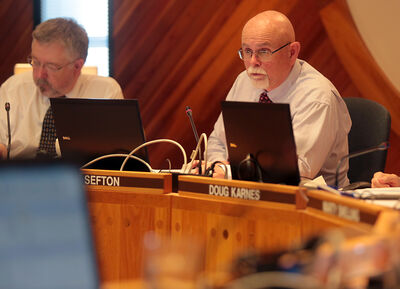 Chair Mark Sefton keeps trustees on task during budget deliberations at the Brandon School Division office on Tuesday. The school board, which has tentatively approved its 2014-15 budget, plans to cut 11 teaching positions and raise taxes by 2.9 per cent.