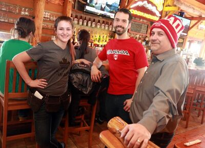 Staff at Montana's Bar and Grill (from left) Sarah McNutt, Aaron Check and B.J. Morrow are preparing for an influx of hockey fans early Sunday morning for the gold medal Olympic match.