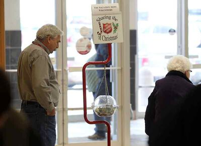 Salvation Army volunteer Brian Hadley helps gather donations at the Shoppers Mall on Thursday afternoon.