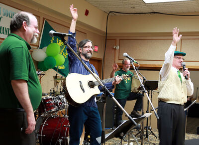 Members of the New Celtic String Band featuring the Uillean Pipes wave to the crowd at the Irish pavilion on Friday evening at the Royal Oak Inn during the 11th annual Lieutenant Governor's Winter Festival.
