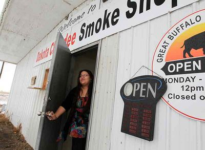 Employee Claire Blacksmith tends the window at the Dakota Chundee Smoke Shop, east of Pipestone, on Monday afternoon. Canupawakpa Chief Frank Brown was fined $10,000 and the building was shut down by a provincial court order announced on Monday.
