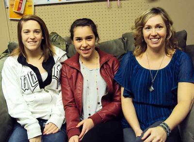 Grade 11 student Marlene Vega, centre, poses for a photo with her host mother Kim Burgess, right, and host sister and Grade 11 student Kaitlyn Burgess. Vega is one of 25 international students currently studying in southwestern Manitoba.