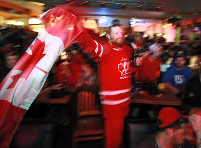 Dallas Bridgeman cheers along with the crowd at Houstons Country Roadhouse as Team Canada wins gold in Olympic men's hockey on Sunday morning.