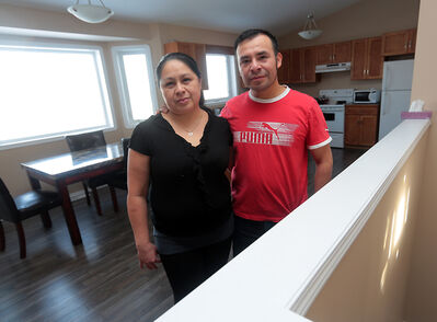 Elena and Mario Ceron stand inside their STEPP home on Rosser Avenue. Mario says anything that can be done to make homes more accessible would be helpful to families new to the area.