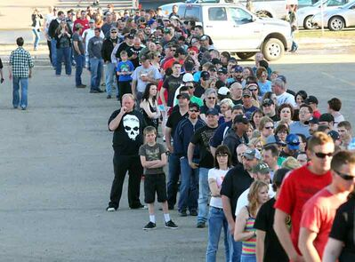 A long lineup threads its way to the Keystone Centre's east entrance before the Mötley Crüe concert in Westman Place on Monday night.