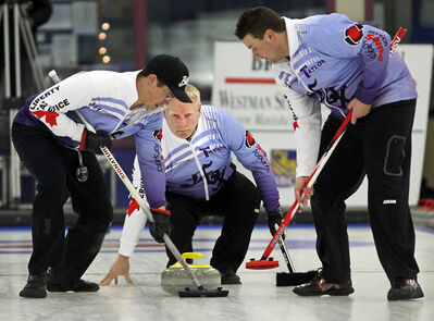 Skip Terry McNamee watches his shot as Travis Taylor and Travis Saban sweep during the Brandon Sun Westman Super League of Curling final at the Brandon Curling Club on Sunday.