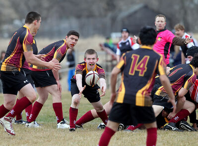 Conor Farren of the Crocus Plainsmen passes the ball during a Westman High School Rugby League game against the Swan Valley Tigers at John Reilly Field on Friday evening.