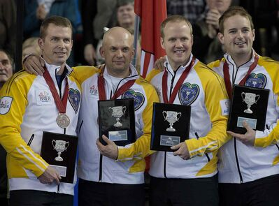 Manitoba's Jeff Stoughton, Jon Mead, Mark Nichols and Reid Carruthers, left to right, display their awards after winning the bronze medal at the Tim Hortons Brier in Kamloops, B.C. on Sunday.