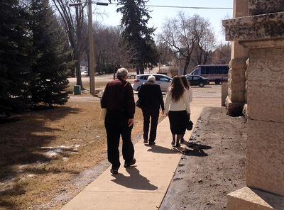 Two Old Order Mennonite women leave a western Manitoba courthouse with Henry and Hilda Dueck. The women have been staying with the Duecks in Winkler since their release on bail over allegations that they interfered with children in CFS care. The women were sentenced on Tuesday.