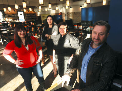 Restaurateur Anna Dumas, from left, Sarah Barbeau, and chef Rebekah Roberts are thrilled with the work that Phil Dorn, president of Samson Engineering, has done to transform the former Central Fire Station No. 1 into the Prairie Firehouse.
