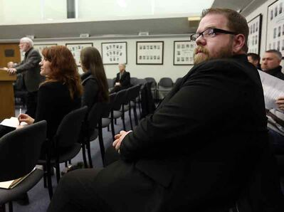 Renaissance Brandon chair Shaun Cameron listens in the public gallery to proceedings at the city council meeting on Monday evening.