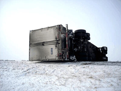 Emergency crews attended the scene of a rollover collision involving a semi-trailer on the east bound lane of the Trans-Canada Highway, one and half miles east of Virden on Friday. (Courtesy Virden RCMP)