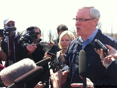 Premier Greg Selinger speaks to media outside the site of the dike breach this morning at Hoop and Holler Bend.