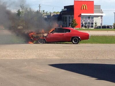A classic car burns on Highland Avenue in Brandon, on Wednesday morning.