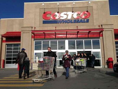 Shoppers leave a Costco store in Montreal on Saturday. A parcel of land south of Brandon near Highway 10 has been sold to a Winnipeg developer, fuelling speculation that Costco has expressed interest in establishing a store in the Wheat City.