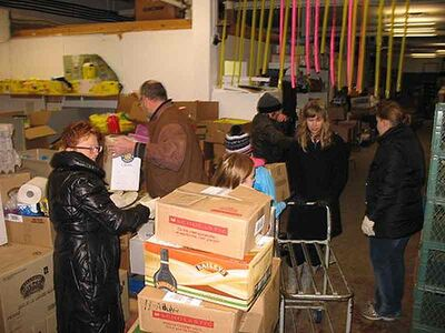 A group of volunteers sorts and organizes the more than 2,600 books that were donated in Brandon.