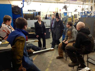 Education Minister Nancy Allan visits with fourth-year welding students at Crocus Plains high school on Thursday. A new $800,000 ventilation system, to improve energy efficiency and indoor air quality for students and staff, was recently installed in the school's welding shop.