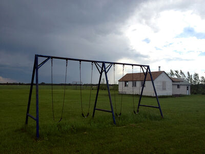 A swing set stands empty outside a home at a Manitoba Mennonite community after children were seized by CFS last June.
