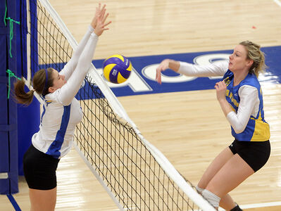 Brandon Bobcats middle Meaghan Robertson swings at UBC Okanagan Heat's Brianna Beamish on Friday night.
