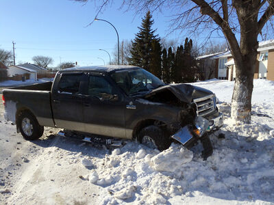 An eastbound pickup truck (above) hit a parked vehicle on the 2400-block of Brandon Avenue on Sunday afternoon. A 37-year-old man Brandon faces several charges, including impaired driving, theft of a motor vehicle and theft under $5,000.