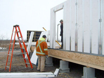 Contractors with Home Hardware in Virden learn to build a house frame with structural Thermal Energy Efficient Panels (STEEP) Building System technology which will be used for seven new homes in Sioux Valley Dakota Nation.