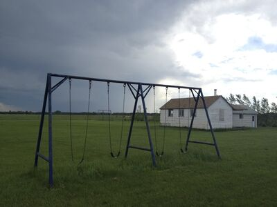 """In this file photo, a swing set stands empty outside a home at a Manitoba Old Order Mennonite community last summer. Child and Family Services apprehended the community's children due to allegations of physical abuse related to extreme discipline.  Cutline 2: A swing set stands empty outside the one-room school house at a Manitoba Old   Order Mennonite community. Child and Family Services has apprehended the community's children due to allegations of physical abuse related to """"discipline"""".  Cutline3: The classroom at an Old Order Mennonite community remains empty. Child and Family Services has apprehended the community's children due to allegations of physical abuse related to """"discipline""""."""