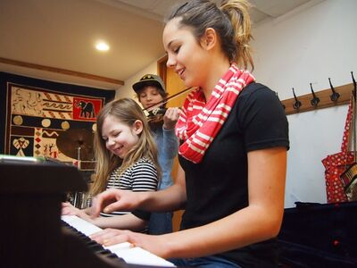 Hallie Unger and her sister Indiana play the piano while their brother Matteo plays his violin during music lessons at their home in Brandon. The three siblings have been home schooled by their mother, Christy for their entire lives.