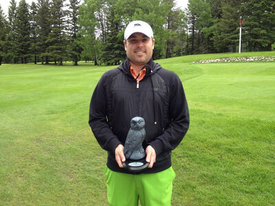 Jared Jacobson poses with his trophy after winning the Grey Owl golf tournament over the weekend.