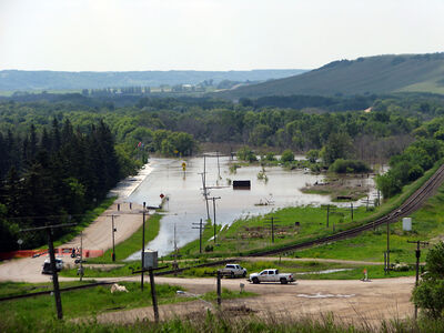 Water from the Qu'Appelle River flows over Highway 41 in St. Lazare Tuesday as flood levels increase in the area.