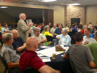 Consultant Peter Smith gets the public workshop underway during the city's Greenspace Master Plan public workshop on Wednesday evening. The nearly 100 residents in attendance were asked to identify their greenspace priorities.