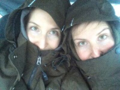 Tiffany and Tara Green huddle together while stranded in their car on the Trans-Canada Highway, where they were at a standstill for 15 hours.