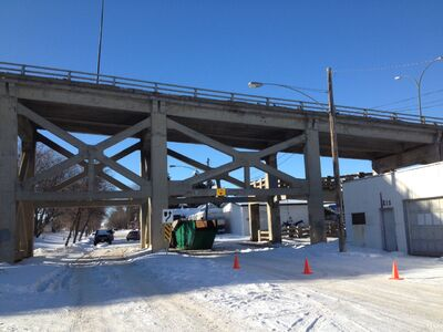 A garbage truck appears to be responsible for closing the Eighth Street Bridge on Tuesday, after hitting concrete crossbeams under the bridge along Assiniboine Avenue. The bridge will be closed indefinitely as engineers assess the damage.