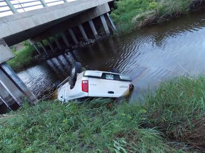 A pickup truck rolled into the Little Souris River early Friday morning, south of Brandon.