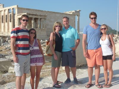 Cam Plante and his wife Valerie, middle, during a trip to Greece three ago. Their son Alex and his son Fanny are pictured left with their other son Tyler and his wife Jordana right.