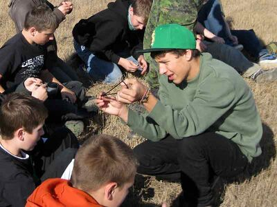 MBdr Konnor Chelkowski from CFB Shilo's Army Cadets C Troop instructing first-year cadets on knot tieing.