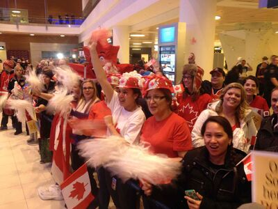 Fans wait at the Winnipeg airport for the curling team of Jennifer Jones, which snagged the gold medal at the Sochi Olympics.