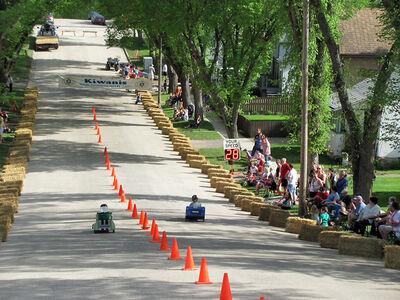 Participants race their go-carts down Rideau Street hill at Lorne Avenue East.