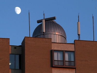 The moon rises over the Brandon University observatory in this file photo.