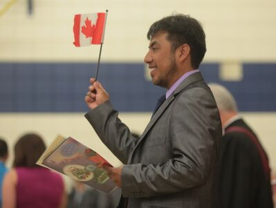 Armando Ruiz waves a Canadian flag after taking his Oath of Citizenship during a ceremony held at Waverly Park School on Thursday afternoon. Ruiz came to Canada from his birth country of Colombia. (Bruce Bumstead/Brandon Sun)