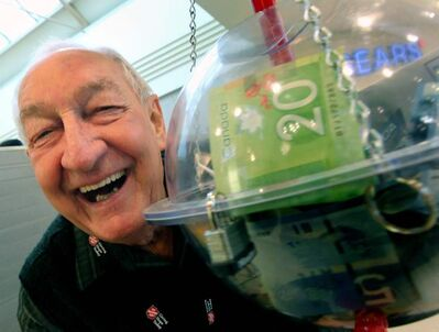 Salvation Army volunteer Phil Guliov collects donations from shoppers at Polo Park Thursday.