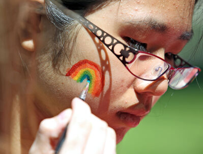 Rebecca Xie with the Neelin High School Gay-Straight Alliance gets a rainbow painted on her cheek during Brandon Pride Weekend events in Princess Park last year.