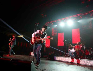 "The Tragically Hip rocks out in front of fans at Westman Place during the Canadian rockers tour stop in Brandon in support of their album ""Now For Plan A"" on Monday evening. Arkells opened for the Hip."