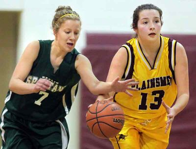 Neelin's Hannah Patten, left, steals the ball from Desirae Peiffer of Crocus Plains during Game 1 of the Brandon High School Basketball League varsity girls' final on Thursday.