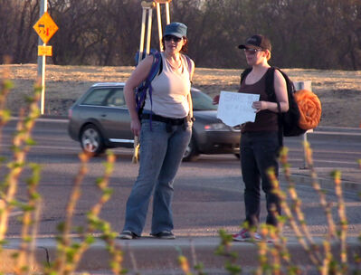 A video still shot by Bob Pierce shows Carmen Perret-Smith, left, and Tiffany Butler taking turns panhandling last Friday night in downtown Brandon. The pair were part of a Westman Youth for Christ team that volunteered to be homeless for a night to help raise funds for U-Turn programming.