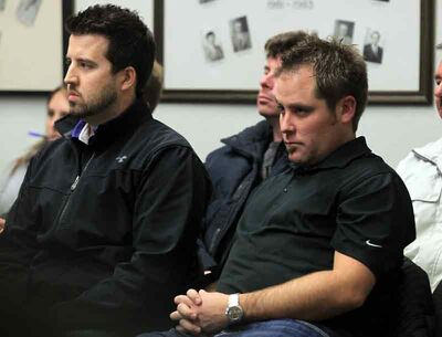 Developers Steve McMillan (left) and Jared Jacobson listen to the start of last night's city council meeting.