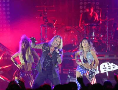 Lead singer Vince Neil and drummer Tommy Lee take centre stage during the Mötley Crüe concert at Westman Place in the Keystone Centre on Monday night.
