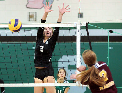 Emma Ciprick goes up for the block for the Neelin Spartans in volleyball action this season.