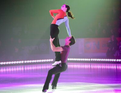 Scott Moir lifts Tessa Virtue into the air during their performance at Westoba Place on Sunday.