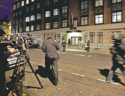 Alastair Grant / The Associated PressThe media stake out the King Edward VII hospital, catching a photo of Prince William (right) on his way out.