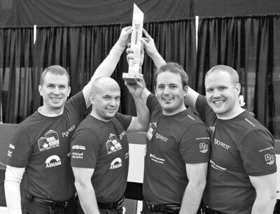 THE CANADIAN PRESSSkip Jeff Stoughton (from left), Jon Mead, Reid Carruthers and Mark Nichols hoist the tiny trophy after their big win.